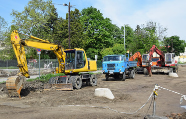 Excavators and truck at the road construction