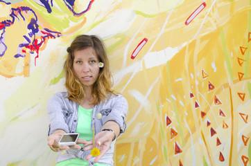 Brunette girl posing against a colorful backdrop