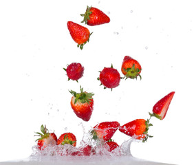 Strawberries in water splash on white backround