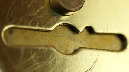 Key sliding into lock and locking\ unlocking door.