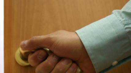 Men's hand opens / closes the door. 4K UHD video.