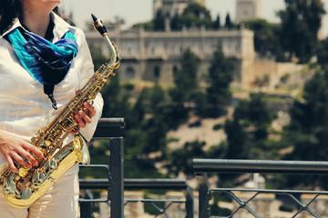 Saxophonist holding saxophone