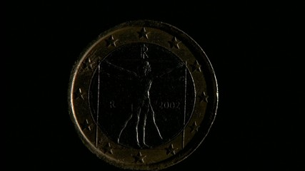 One euro back coin isolated on black background. Rotation.