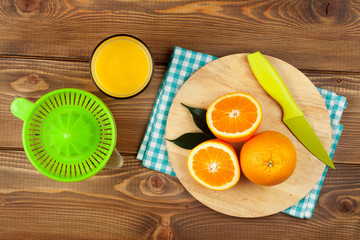 Orange fruits and glass of juice
