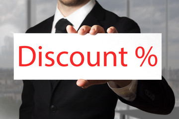 businessman pointing on sign discount percentage symbol