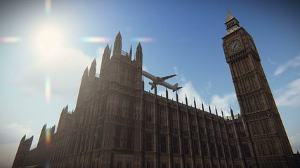 Airliner flying over The Palace of Westminster in London