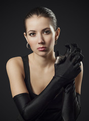 Woman in Black Gloves with Ring Joint