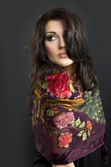 Attractive brunette in a bright attire on a black background.