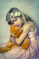 beautiful blond child with toy