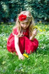 blond girl picking flowers