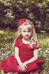 blond girl in meadow retro effect