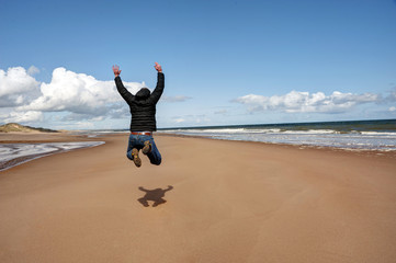 Man jumping for joy on the beach