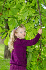 beautiful blond girl with green tree