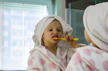 portrait of girl in dressing-gown with towel over head