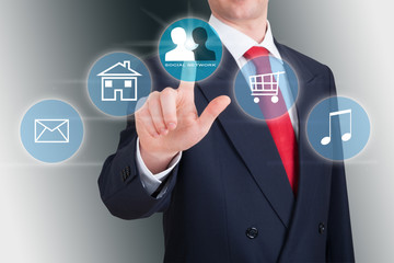 Businessman pointing a social icon