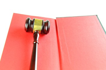 Justice concept with gavel against red book