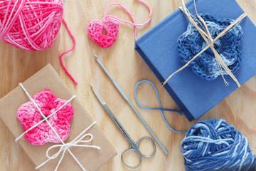 Handmade pink, blue crochet flowers and heart on gift