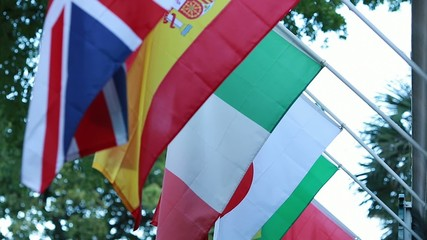 Flags from Japan, Spain, Italy, Brazil and England in street