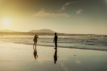 silhouettes of a couple at beach