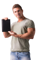 Smiling young man holding and showing book cover