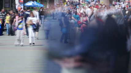 Time lapse of crowd walking in a street.