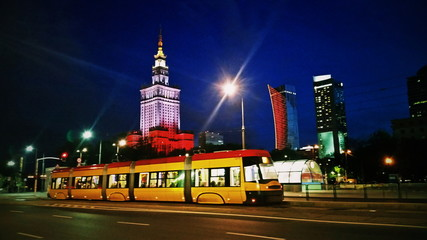 Tram on Warsaw city street at evening or night
