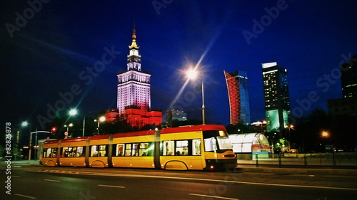 Zdjęcia na płótnie, fototapety na wymiar, obrazy na ścianę : Tram on Warsaw city street at evening or night