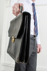 Man showing a leather briefcase
