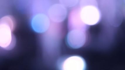 Blurred violet background on dark