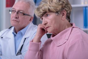 Sorrowful woman in doctor's office