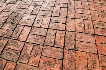 Red brick paving on a sidewalk at Ayutthaya, world heritage, Tha