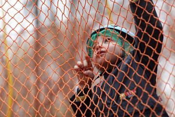 Kid climbing into a net