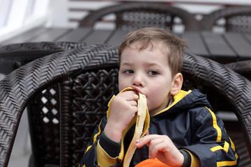 Kid eating banana
