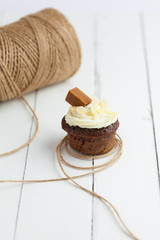 Homemade chocolate cupcake on wooden table
