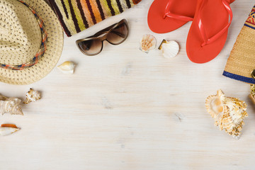 Top view of summer beach accessories on wooden background