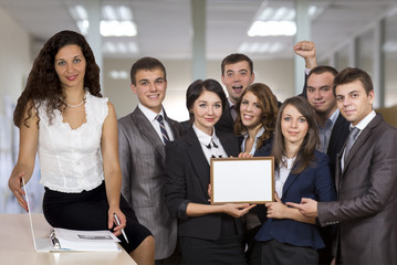 Female business trainer in front of the happy graduates