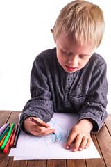 Little boy draws a drawing