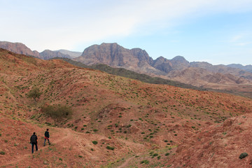 Tourists hiking the mountains in the Feynan natural Reserve