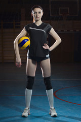Female volleyball player with a ball