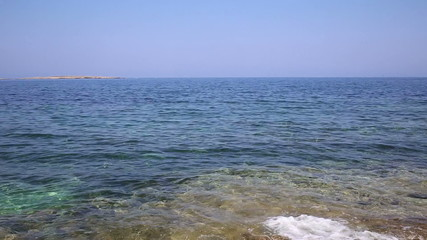 Ocean waves on rocky coast of Malta (looping)