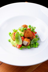 Fried Octopus on basil mousse, green peas and fresh strawberries