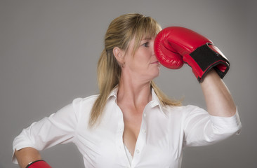 Female boxer wearing red boxing gloves