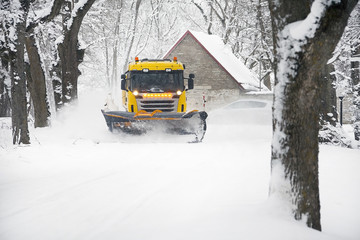 Snowplow Truck Removing the Snow from the village road