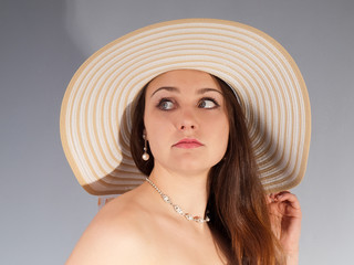 Romantic girl in hat with long thick dense hair