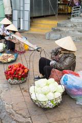 Vietnamese vendors selling fruit and vegetables at Dalat market