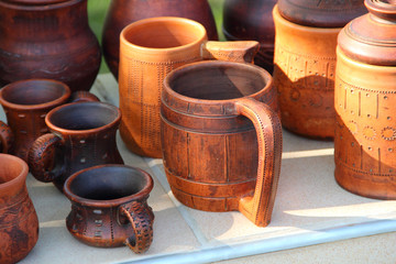 Ceramic brown mug among ceramic ware