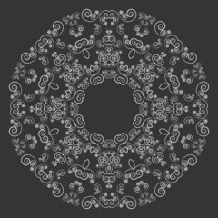 Round lacy pattern on black background