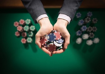 Casino playes holding a handful of chips