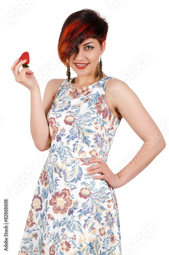 Young girl holding a strawberry. Isolated on white Poster