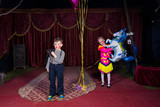 Boy Clown on Stage with Girl Holding Horse Balloon